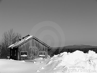 Winter: maple sugar shack in snow