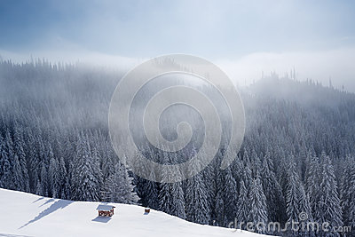 Winter mountain landscape with blue sky