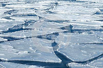 Blocks of ice on frozen blue Sea