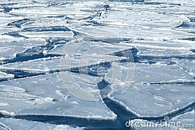 Blocks of ice on frozen blue Sea