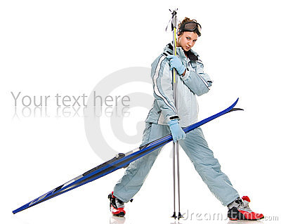 Winter nice girl in grey sports suit and with skis
