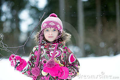 Winter portrait of adorable child girl in jumper