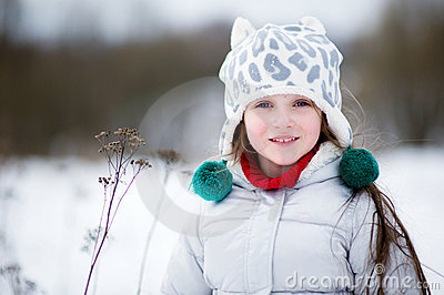Winter portrait of adorable smiling child girl
