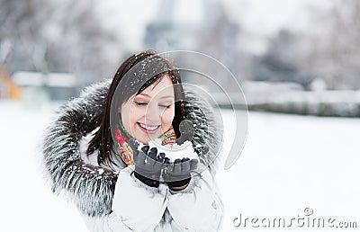 Winter portrait of a beautiful girl in fur hood