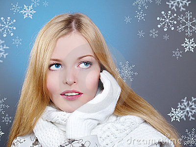 Winter portrait of a beautiful woman is freezing