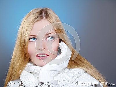 Winter portrait of a beautiful woman is freezing