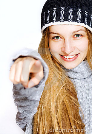 Winter portrait of happy woman pointing