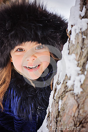 Free Winter Portrait Of Cute Smiling Child Girl On The Walk In Sunny Snowy Forest Stock Photography - 49820322