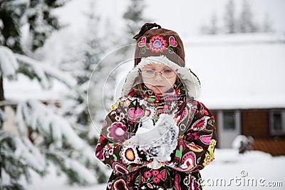 Winter portrait of playful child girl