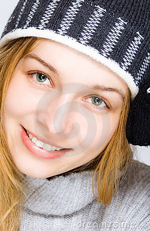Winter portrait of woman with beautiful smile