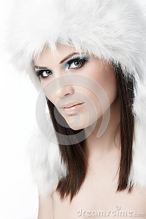 Winter portrait of woman in fur cap