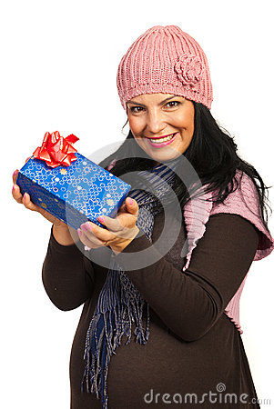 Winter pregnant holding presents
