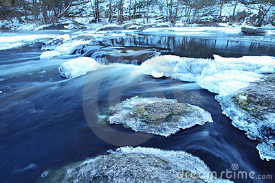 Winter river with deeply  blue water. A landscape