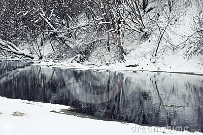 Winter river in snow with trees