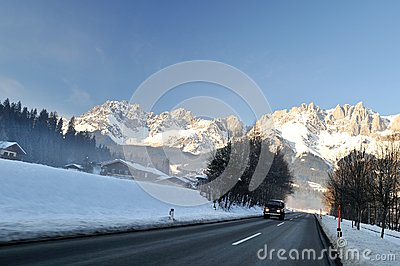 Winter road transient in Alps