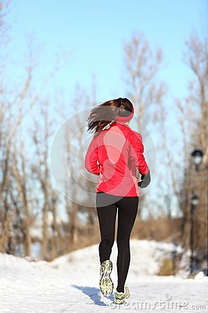 Winter running woman in snow