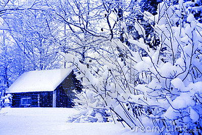 Winter rural house under snowfall