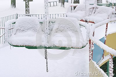 Winter scene with snowy chairs