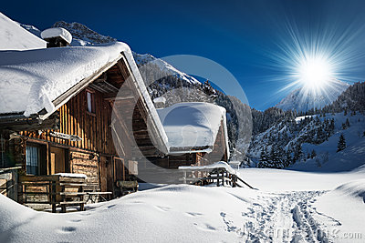 Winter ski chalet and cabin in snow mountain