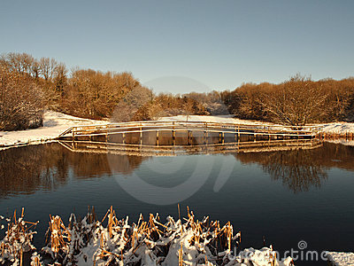 Winter snow scene - fishing lake in Wales