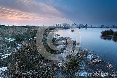 Winter sunrise over river
