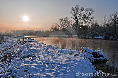 Winter sunrise over snowy river