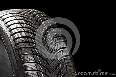 Winter tyre on black