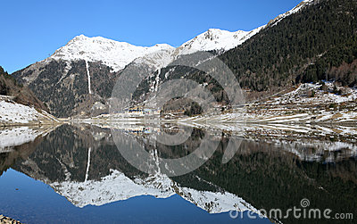 Winter view of mountain lake in the Atlantic Pyrenees.