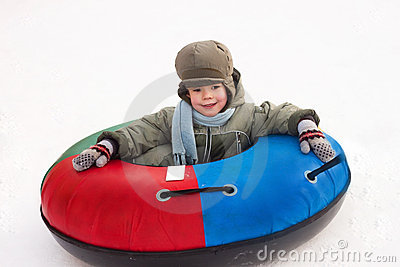 Winter walk, boy rides a Snow-tubing