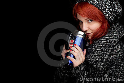 Winter woman with big blue cup