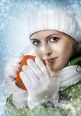 Free Winter. Woman Drink From Orange Cap. Stock Photos - 21568553