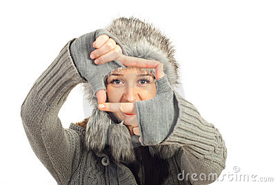 Winter woman framing her eyes