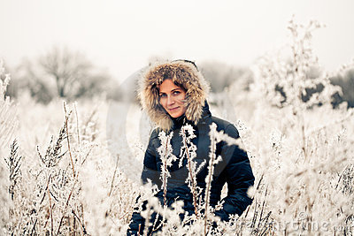 Winter woman in a frozen plant