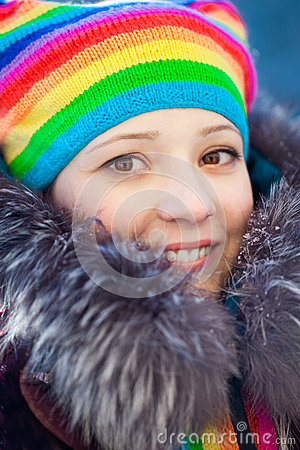 Free Winter Woman In Rainbow Hat Royalty Free Stock Images - 25453129