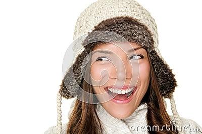 Winter woman looking sideways happy
