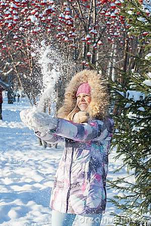 Winter woman play with snow