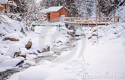 Winter wood cabin in the mountains Stock Photo