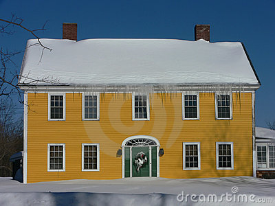 Winter: yellow house in snow