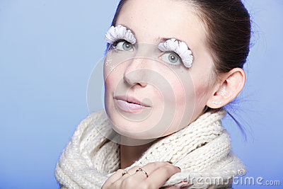 Winter young woman portrait with white eye-lashes