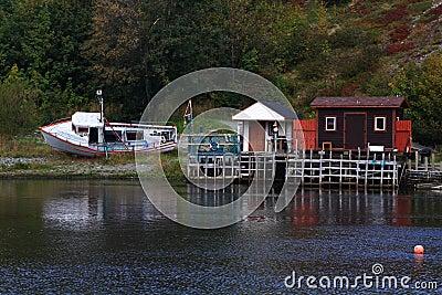 Winterized fishing dock and cabins in Quidi Vidi Harbor, Newfoundland.