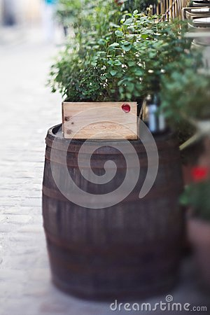 Winy barrel with a table on background a municipal street