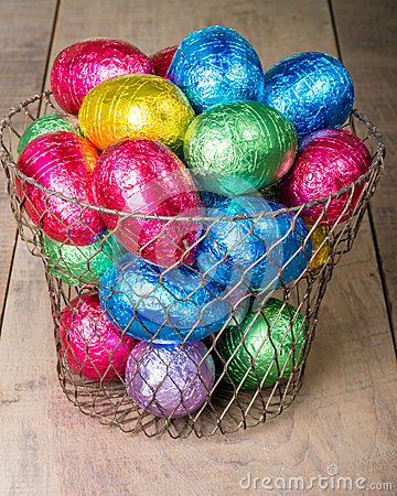 Wire egg basket with colorful eggs