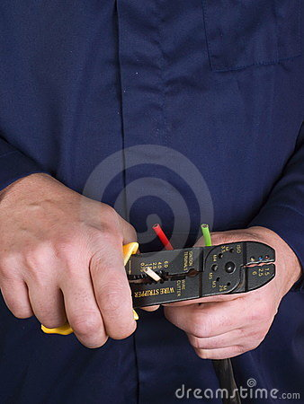 Free Wire Stripper   In The Hands Royalty Free Stock Photography - 12642557