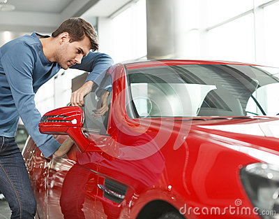 Wish it were my car. Handsome young men standing near the red sp
