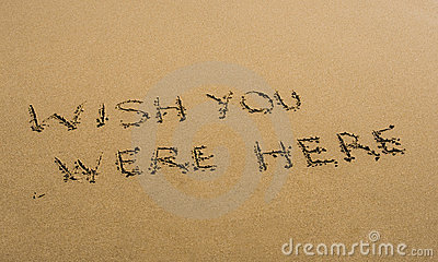 Wish You Were Here written in sand