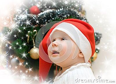 Wishing girl in red Santa hat