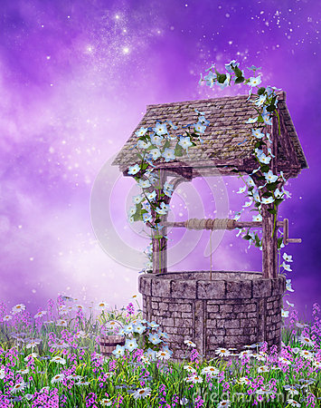 Wishing well on a colorful meadow
