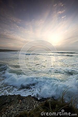 Wispy sky across sea