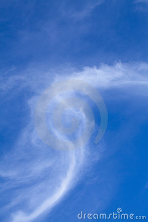 Wispy white Cirrus cloud against blue sky