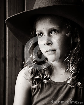 Wistful Little Girl In Cowboy Hat Stock Photos - Image ...